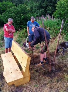 Setting the bench in place with the right view - a work of science on a slope !