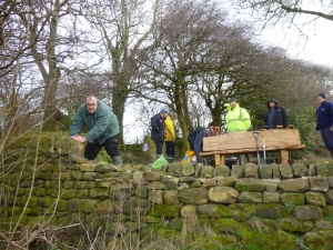 Open Country Members Repairing the Vandalised Wall