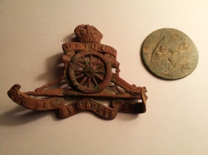 Brass Cap Badge from The Royal Artillery & 1914 Half-Penny recently found in the Park.